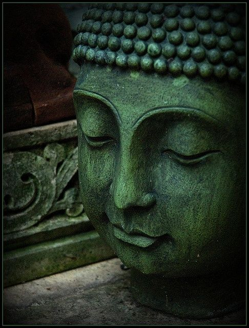 Green statue of Buddha by Cyost on flickr.com