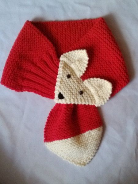 Red Hand Knit Fox scarf Made with acrylic yarn. The scarf is very cute warm and nice Size: length: 29 ~ 30( 76-79 cm ) width: 6-6,5 (14-17
