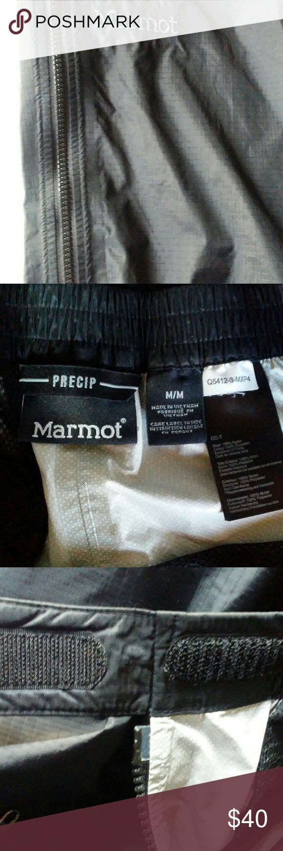PRECIP MARMOT. Women's Full zip pants These are black windpants in very good shape. Worn once, no tears, snags or holes.  These pants zip up on both sides top to bottom with velcro at ends and buttons on bottom. 2 front pocket with zippers. One bk pocket with zipper.  Elastic waistline.      They are 42 in in length. Marmot Pants Track Pants & Joggers