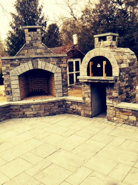 The Ferriola Family Wood Fired Brick Pizza Oven and Outdoor Fireplace in New York.  BrickWoodOvens.com