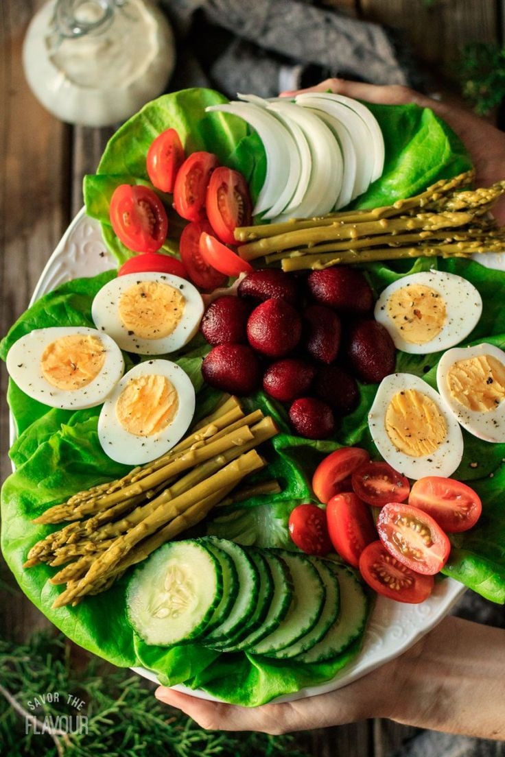 Irish Pub Salad: a simple, healthy lunch idea for St. Patrick's Day alongside soda bread or potato soup. Forget the corned beef and try something new! Fill your plate with green vegetables, boiled eggs, cucumber, pickled beets, and crisp lettuce—all drizzled with the perfect salad dressing.   www.savortheflavour.com #stpatricksday #irish #salad #vegetarian #recipe