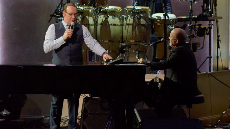 """""""House of Cards"""" star Kevin Spacey took his harmonica to PBS's """"Billy Joel: The Library of Congress Gershwin Prize,"""" where he played and sang his way through the musician's legendary """"Piano Man."""" Tony Bennett, Boyz II Men, Gavin DeGraw, Josh Groban, Natalie Maines and LeAnn Rimes also joined in"""