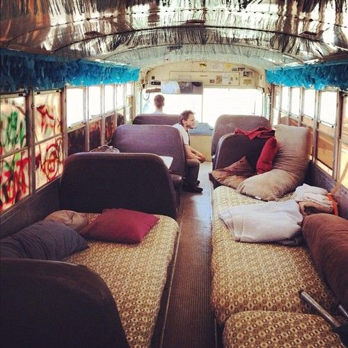 buy an old bus, replace seats with beds and take a road