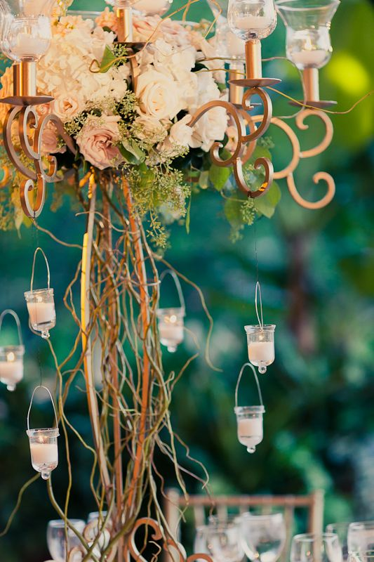 Gold candelabra with branches and candles centerpiece