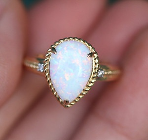 although I dont like pear shaped i love this...its like old school look! <3 Pear Shaped Teardrop Opal Diamond Ring 10k Yellow Gold New October Birthstone