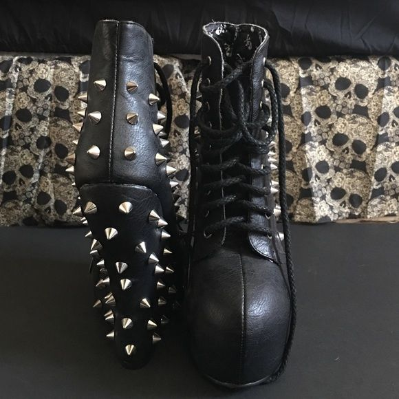 BELLADONA BOOTS BY BETTIE PAGE Sz 7 Authentic, brand new, never worn, mint condition, black PU leather, curved wedge, lace up Bettie Page ankle booties with silver metal spikes all along the backs and sides. No original box, new USPS box will be used. Bettie Page Shoes Ankle Boots & Booties