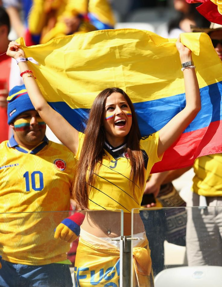 These fans of Team Colombia fly their national flag during the game against Greece.
