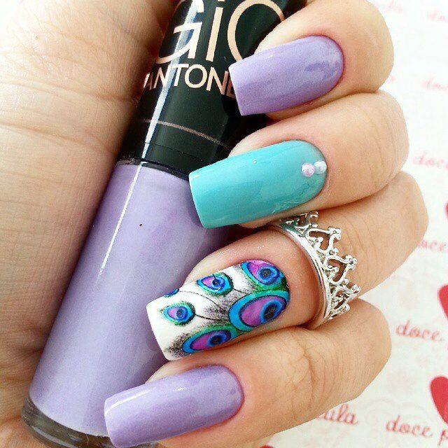 Pastel purple and blue with peacock accent nail