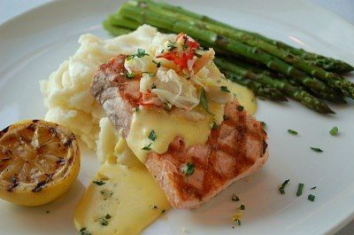Wild Alaskan Salmon Oscar Fresh Dungeness Crab, Asparagus with Béarnaise Sauce and Parmesan Mashed Potatoes at Stanford's Restaurant & Bar in Seattle Southside
