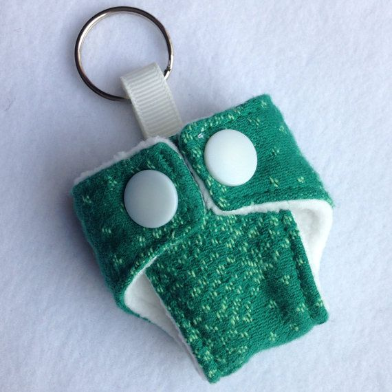 Cute Mini Cloth Nappy Keyring made with Oscha Starry Night Ash wrap scrap Great accessory for your changing bag Fleece lined and working snaps  If you have any questions, please feel free to send me a message!  You can also find me on Facebook https://www.facebook.com/pages/Girls-Got-Fabric
