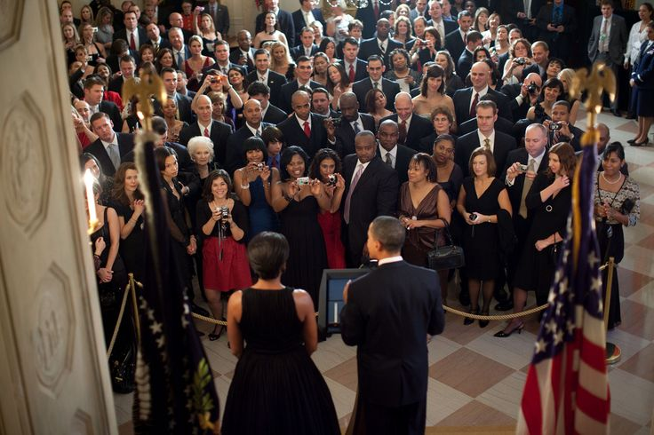 Dec. 13, 2009: President Obama and First Lady Michelle Obama address guests in the Grand Foyer of the White House during a holiday part (Photo by Pete Souza)
