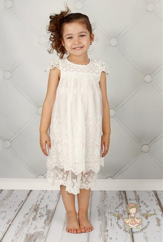 This tea length dress is to cute for words. Vintage off white dress with a English net lace overlay and has a overlay of beautiful soft