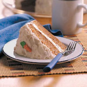 Old-Fashioned Carrot Cake with Cream Cheese Frosting Recipe -A pleasingly moist cake, this treat is the one I requested that my mom make each year for my birthday. It's dotted with sweet carrots and a hint of cinnamon. The fluffy buttery frosting is scrumptious with chopped walnuts stirred in. One piece of this cake is never enough!—Kim Orr, West Grove, Pennsylvania
