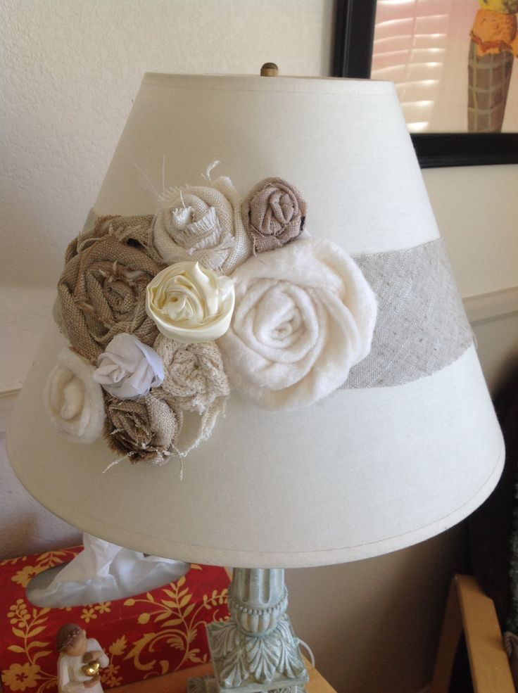 A pretty way to dress up a lampshade. Pretty fabric roses.