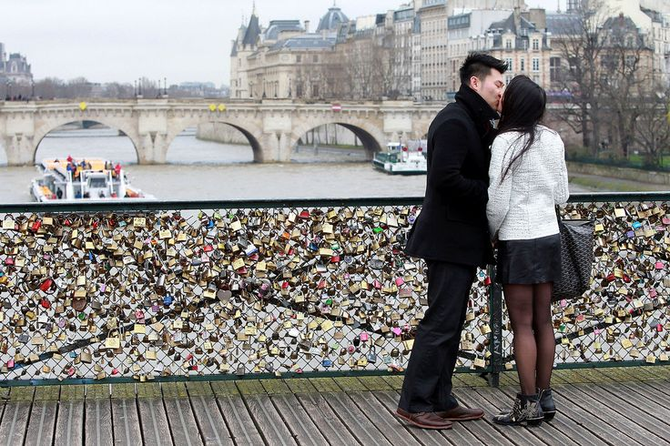 It's a little sappy, but it Paris. The Ponts Des Artes...a famous bridge in Paris where couples attach a lock adorned with their names/initials and then throw the key into river below. Think Matt and I should do this.