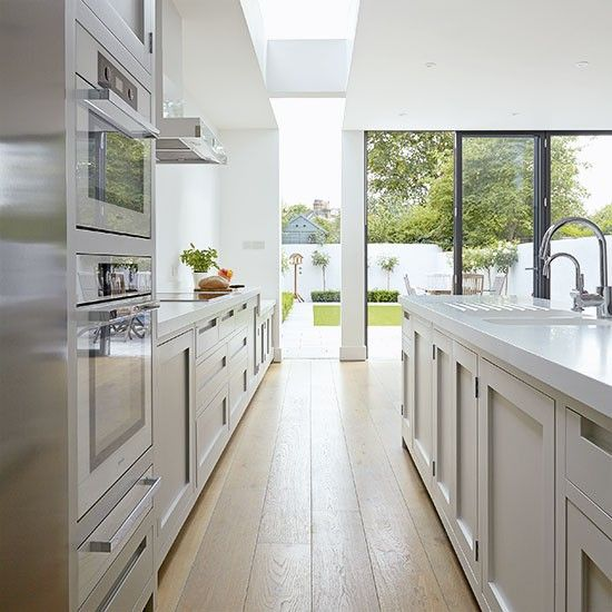 This fabulous side extension is dissected by glass where the existing property meets the new addition, bringing natural light into the full depth of the kitchen and creating a striking architectural feature