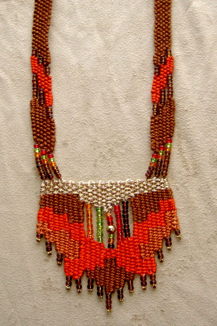 """Fire"" - Early work from 1990's - Adjustable length, stair-step design with straps. SOLD. Woven by Terri Scache Harris, theravenscache.shutterfly.com Hand woven, handwoven, weaving, weave, needleweaving, pin weaving, woven necklace, fashion necklace, wearable art, fiber art."