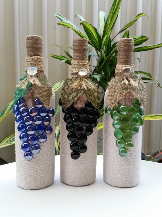 GRAPE STYLE TWINE WRAPPED WINE BOTTLE SOLD SEPARATELY OR AS SET - $8.00 PER BOTTLE LOVELY ADDITION TO ANY HOME DECOR. USE AS TABLE CENTRE, BAR DECORATION OR VASE (DRIED ARRANGEMENTS ONLY) CAN BE CUSTOM MADE TO SUIT YOUR DECOR, DEPENDING ON AVAILABILITY OF MATERIALS.