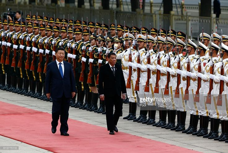 President of the Philippines Rodrigo Duterte and Chinese President Xi Jinping review the honor guard as they attend a welcoming ceremony at the Great Hall of the People on October 20, 2016 in Beijing, China. Philippine President Rodrigo Duterte is on a four-day state visit to China, his first since taking power in late June, with the aim of improving bilateral relations.