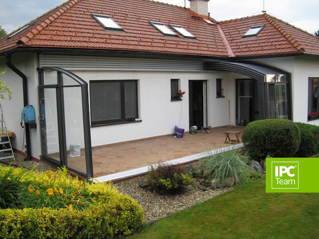 fully open patio enclosure attached to a house