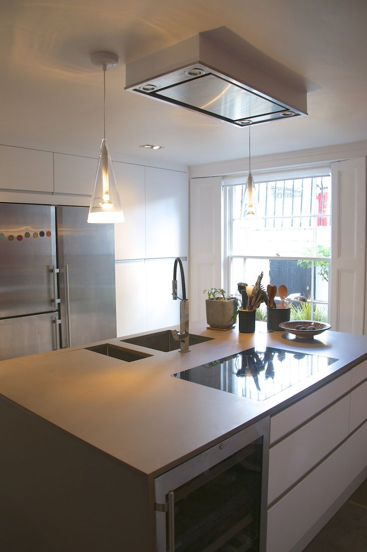 The island has a double sink, a dishwasher, an induction hob, a wine fridge and lots of storage.