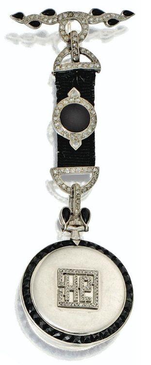 Art Deco platinum, onyx, and diamond pendant-watch by Cartier, circa 1910. Via Sotheby's.