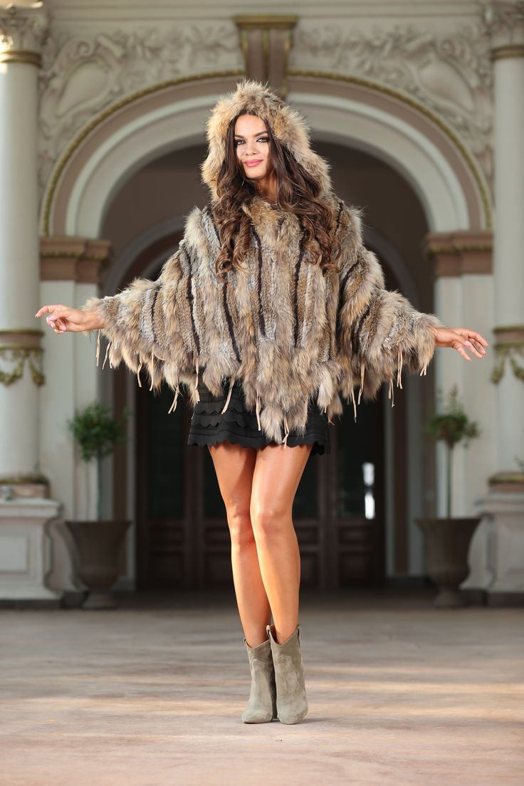 Doris  Time to bring a little Hollywood glamour to your casual outfits this fall. This fur poncho in striped camel is just the way to do it darling! This amazing poncho does not only provide you with warmth, but is also the best tool to create a chic style. A great piece always comes with great details: fur finish, hooded neckline, luxurious design…if you've ever wanted a perfect vest, this is the one. Composition: 100% real fur