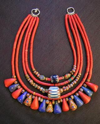 necklace of red heishi, a  spectacular grouping of antique kiffa beads, and two beautiful seven-layer  chevrons, each 400-500 years old. Vintage kiffa beads were made in a  painstaking and incredibly time-consuming process by elderly women in Mauritania.