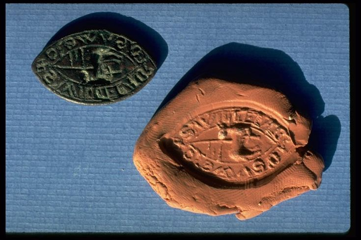 Seal matrix, engraved with an Agnus Dei (Lamb of God). There is an inscription in Lombardic letters around the edge: '+S'WILLI FABRI D'SVWERC', meaning 'seal of William, blacksmith of Southwark'. The word 'fabri' meant blacksmith in the medieval period. It comes from the Latin word 'faber' meaning 'maker' or 'smith'. William would have used the matrix to press into wax to seal and authenticate documents.  Production Date: Early Medieval; 13th century