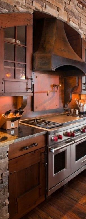 Eclectic Kitchen with Interior stone facade, Flush, Slate, One-wall, Glass panel, Pot filler faucet, Complex granite counters