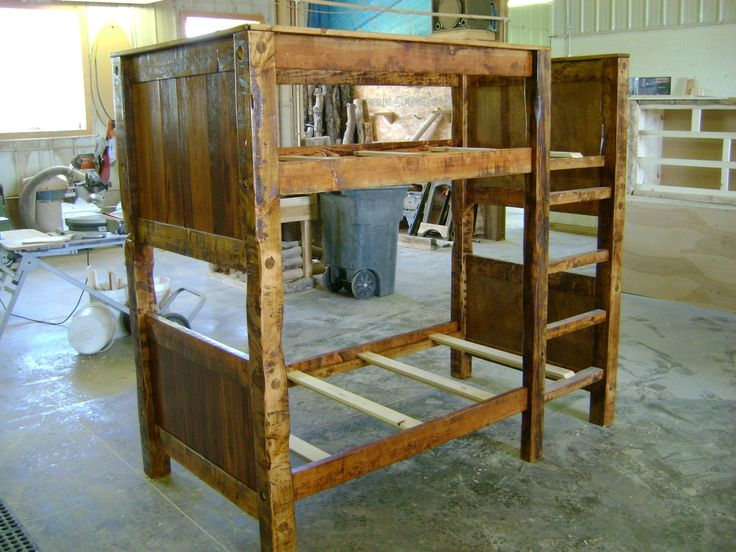 CustomMade by sean Ireland: This is a custom built bunk bed made entirely of reclaimed barn wood.  It is a twin on twin size bunk bed with a built in ladder on the front side.  The side rails slide into the head board and foot board in a mortise and tenon style setup.  The rails are also bolted from the other side with a 8