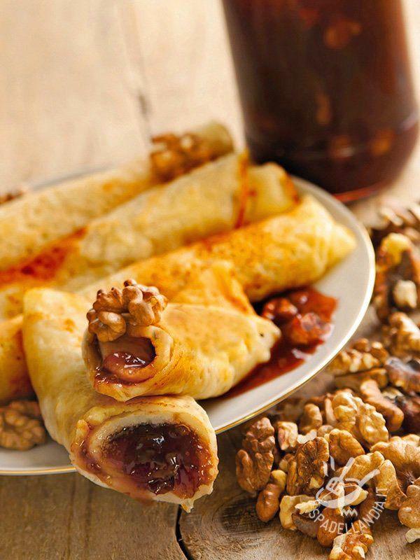Questi sì che sono pancakes originali! Provate subito i Pancakes noci e confettura di susine, sono buonissimi e impreziositi da noci croccanti!