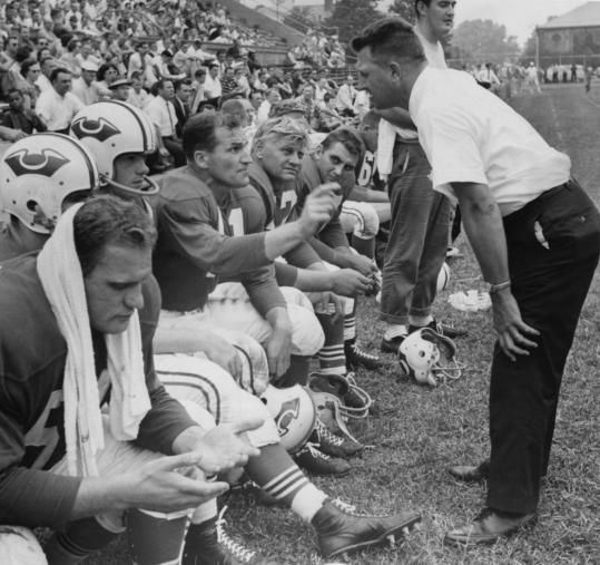Head coach Lou Saban talks with QB Butch Songin during a 1960 exhibition game.