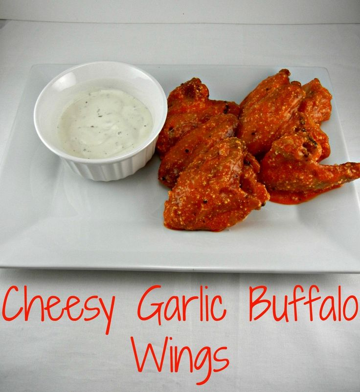The BEST #gameday food - Cheesy Garlic Buffalo Wings. Baked crispy in the oven. Recipe posted at thetastyfork.com