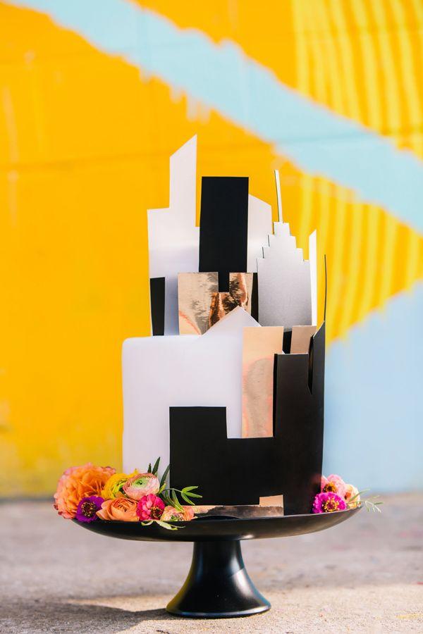 cityscape wedding cake - photo by Vue Photography http://ruffledblog.com/best-of-2014-cakes #weddingcake #cakes