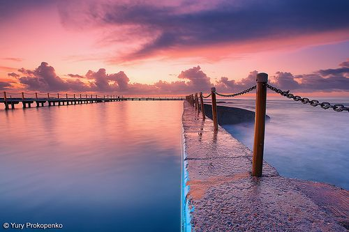 Sunrise over North Narrabeen tidal pool, Northern Beaches, Sydney, Australia