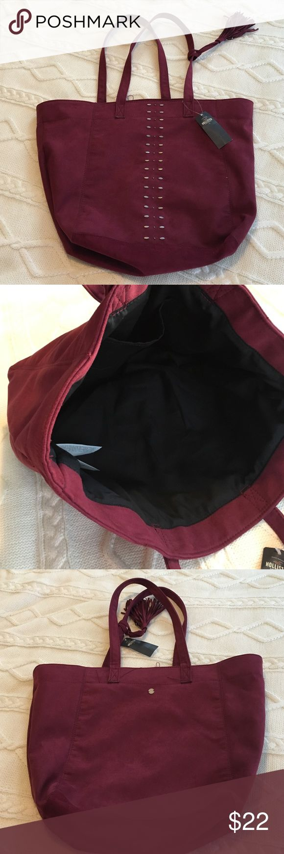 NWT Hollister Tote NWT Maroon Hollister Tote with bronze accents down the center and tassel on the handle. Made of 80% polyester, but has a suede feel to it. The inside is completely black with one pocket. Hollister Bags Totes