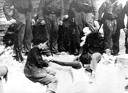 Warsaw, Poland, A woman being forcibly dragged from a bunker during the Warsaw Ghetto Uprising.