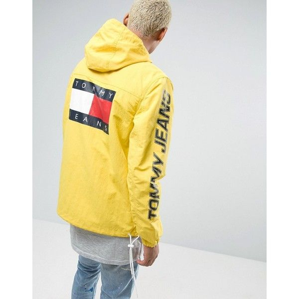 Tommy Jeans 90s Packable Jacket M16 Hooded Overhead in Yellow ($225) ❤ liked on Polyvore featuring men's fashion, men's clothing, men's outerwear, men's jackets, yellow, mens hooded jackets, tall mens jackets, mens waterproof jacket and mens zip jacket