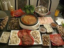 Hot pot (also known as steamboat in Indonesia, Singapore, Malaysia, Thailand, Korea, China, Taiwan, and Brunei) refers to several East Asian varieties of food, consisting of a simmering metal pot of stock at the center of the dining table. While the hot pot is kept simmering, ingredients are placed into the pot and are cooked at the table. Typical hot pot dishes include thinly sliced meat, leaf vegetables, mushrooms, wontons, egg dumplings, tofu, and seafood. The cooked food is usually eaten…