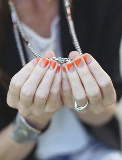orange + nude diagonal nails