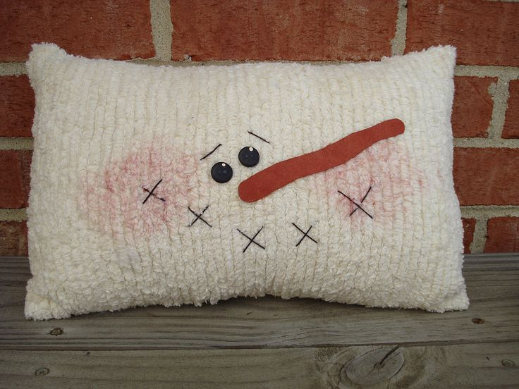 Chenille Snowman Pillow. That could be made out of a wool blanket and felted nose too, and even made round.