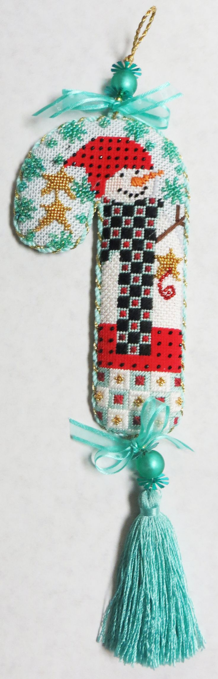 Candy Cane Snowman stitched by Kathy M....interesting colors