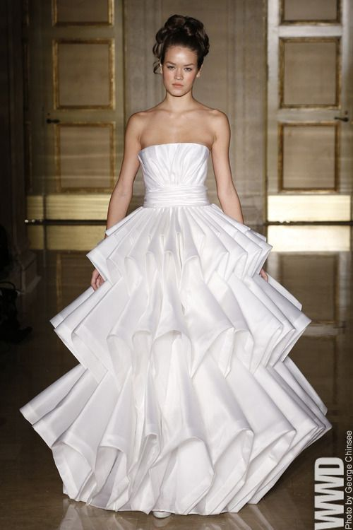 Douglas Hannant Bridal Fall 2013 She doesn't look at all happy to be wearing this dress.