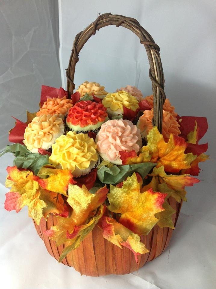 Fall cupcake bouquet, would be very different to teach how to make these instead of just a box of cupcakes to bring home!