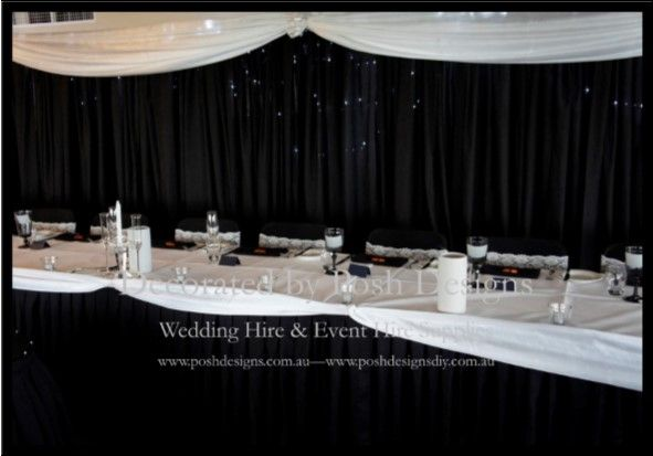 Black bridal backdrop with white swagging and black bridal skirting with white swagging all for hire for your wedding or function. Australia wide. Visit www.poshdesigns.com.au for more photos and info, or email lisa@poshdesigns.com.au for pricing packages.