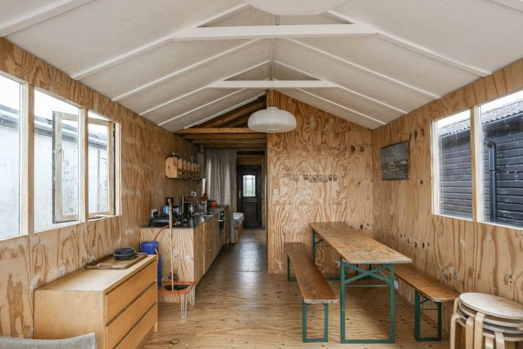 A shuttering plywood-lined interior (grain and knots included) in a tiny beach house in Seasalter, England. See Two London Creatives Shore Up a Tiny Beach House, Ikea Hack Kitchen Included. Photograph courtesy of the Modern House.