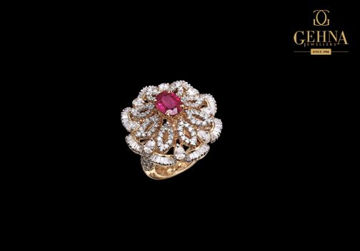 This fabulous cocktail ring with a stunning ruby and white diamonds will add an extra edge to your outfit.