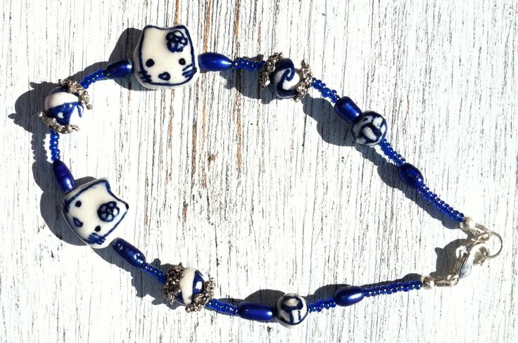 A109 - Ceramic, rice pearls and Sterling Silver