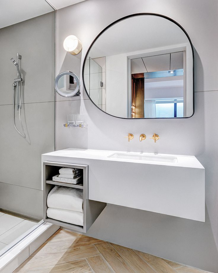 Abstract shaped mirror. Andaz Hotel by Mason Studio